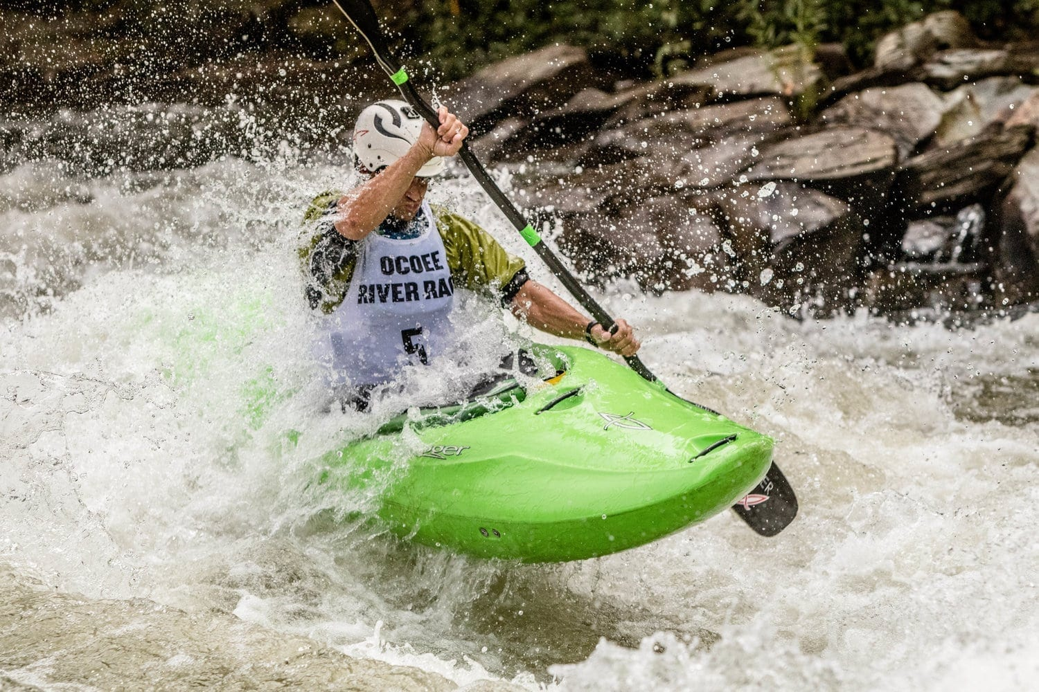 Man paddles a kayak in the Ocoee River Championships